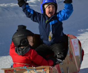 happy child on sled he made